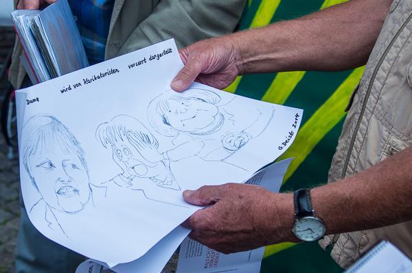 Kulturkreis am Künstlermarkt - Karikaturen werden von Gerhard Deist live gezeichnet.